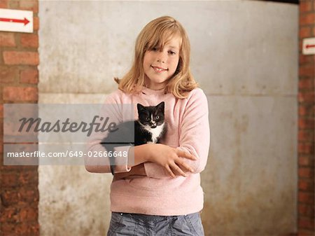 Girl Holding Kitten Stock Photo - Premium Royalty-Free, Image code: 649-02666648