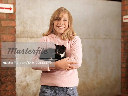 Girl Holding Kitten Stock Photo - Premium Royalty-Free, Image code: 649-02666649