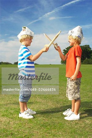 boys with crossed swords Stock Photo - Premium Royalty-Free, Image code: 649-02666836