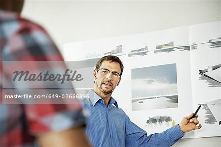Architects working on a project Stock Photo - Premium Royalty-Free, Image code: 649-02666896