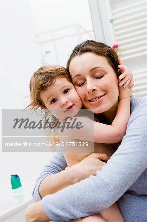 Mother hugging her baby Stock Photo - Premium Royalty-Free, Image code: 649-02731329