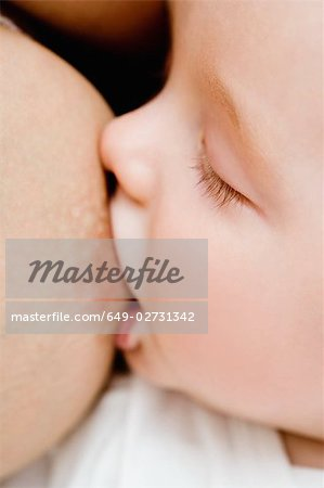 Mother nursing her baby Stock Photo - Premium Royalty-Free, Image code: 649-02731342
