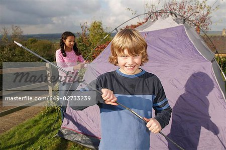 Boy and girl putting up tent Stock Photo - Premium Royalty-Free, Image code: 649-02733239