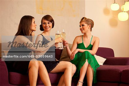 Young women drinking champagne Stock Photo - Premium Royalty-Free, Image code: 649-03009643