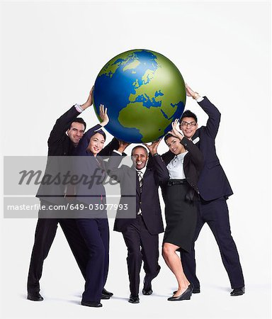 A business group holding up a big globe Stock Photo - Premium Royalty-Free, Image code: 649-03077993