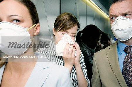 People in a lift during a health alert Stock Photo - Premium Royalty-Free, Image code: 649-03078665