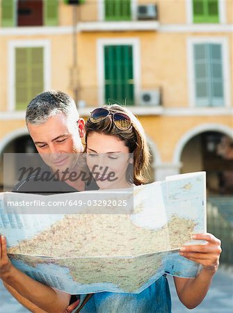 couple looking at a map Stock Photo - Premium Royalty-Free, Image code: 649-03292025