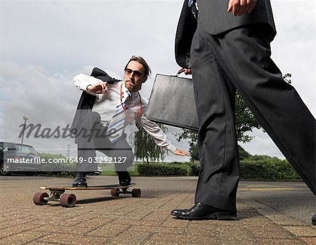 businessman on skateboard Stock Photo - Premium Royalty-Free, Image code: 649-03292127
