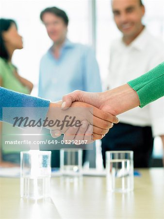 Closing a business deal by shaking hands Stock Photo - Premium Royalty-Free, Image code: 649-03292187