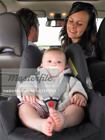 mother watching baby in car seat Stock Photo - Premium Royalty-Free, Image code: 649-03293750