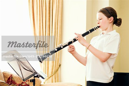 A young girl playing the clarinet Stock Photo - Premium Royalty-Free, Image code: 649-03294679