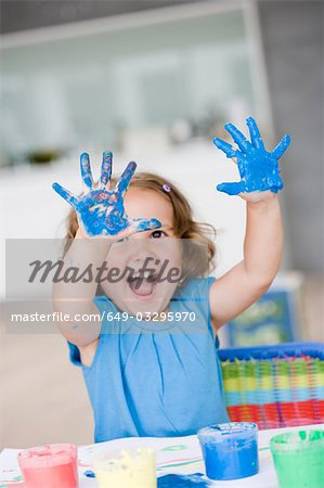 young girl playing with colours Stock Photo - Premium Royalty-Free, Image code: 649-03295970