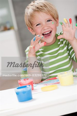 young boy playing with colours Stock Photo - Premium Royalty-Free, Image code: 649-03295972