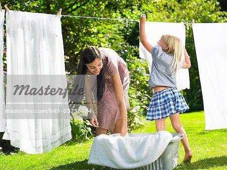 Mother and daughter doing the laundry Stock Photo - Premium Royalty-Free, Image code: 649-03296424