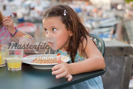 girl eating spaghetti Stock Photo - Premium Royalty-Free, Image code: 649-03296733