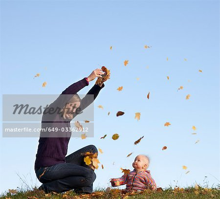 mother and baby throwing autumn leaves Stock Photo - Premium Royalty-Free, Image code: 649-03362912