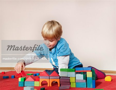 boy with toy building blocks Stock Photo - Premium Royalty-Free, Image code: 649-03362926