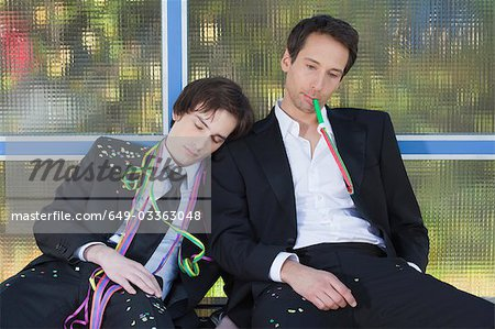 two businessmen at bus stop after party Stock Photo - Premium Royalty-Free, Image code: 649-03363048