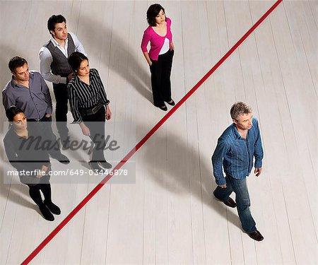 Business men and women crossing red line Stock Photo - Premium Royalty-Free, Image code: 649-03446878