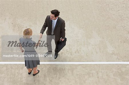 Putting through a deal Stock Photo - Premium Royalty-Free, Image code: 649-03447208