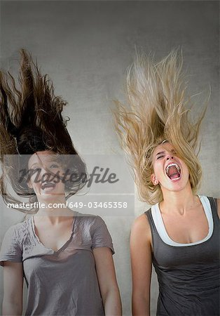 Teen girls laughing together Stock Photo - Premium Royalty-Free, Image code: 649-03465358
