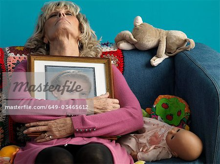 Mature woman asleep with childs picture Stock Photo - Premium Royalty-Free, Image code: 649-03465612