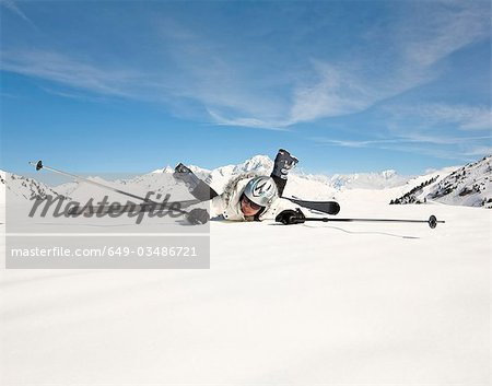 Fallen woman wearing skis, in snow Stock Photo - Premium Royalty-Free, Image code: 649-03486721