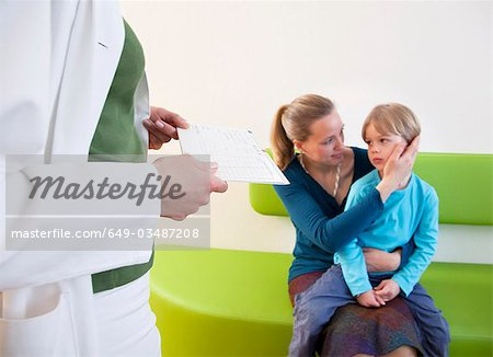 Doctor with patient in waiting area Stock Photo - Premium Royalty-Free, Image code: 649-03487208