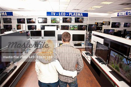 Young Couple in TV section Stock Photo - Premium Royalty-Free, Image code: 649-03487398