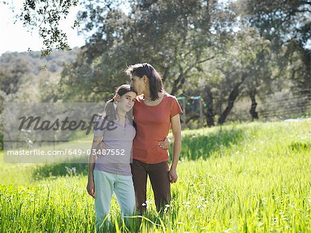 Mother kissing on forehead daughter Stock Photo - Premium Royalty-Free, Image code: 649-03487552
