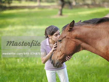 Girl kissing horse on forehead Stock Photo - Premium Royalty-Free, Image code: 649-03487593