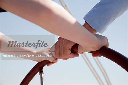 Man and boy steering yacht Stock Photo - Premium Royalty-Free, Image code: 649-03510960