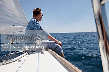 Man on yacht Stock Photo - Premium Royalty-Free, Image code: 649-03510973