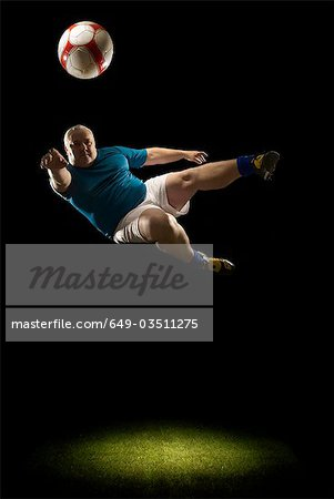 Large man doing flying volley Stock Photo - Premium Royalty-Free, Image code: 649-03511275