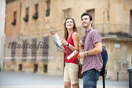 Couple with guidebooks in city square Stock Photo - Premium Royalty-Free, Image code: 649-03566314