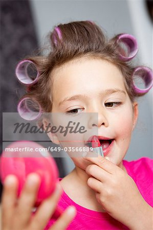 Little Girl using lipstick Stock Photo - Premium Royalty-Free, Image code: 649-03566889
