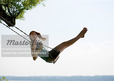 Girl on swing Stock Photo - Premium Royalty-Free, Image code: 649-03606363