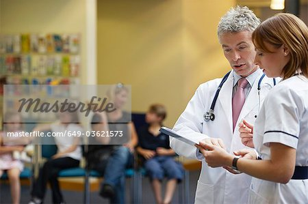 Doctor and nurse in waiting area Stock Photo - Premium Royalty-Free, Image code: 649-03621573