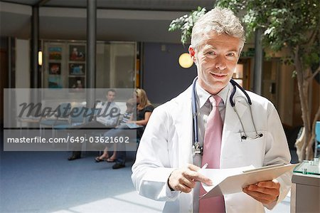 Doctor and patients in waiting area Stock Photo - Premium Royalty-Free, Image code: 649-03621602