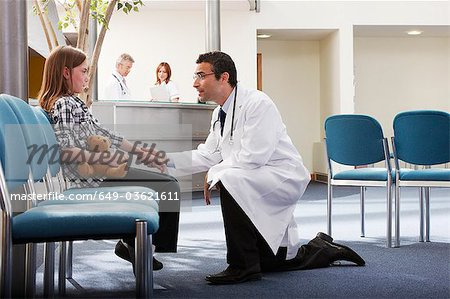 Doctor greeting young girl in surgery Stock Photo - Premium Royalty-Free, Image code: 649-03621611
