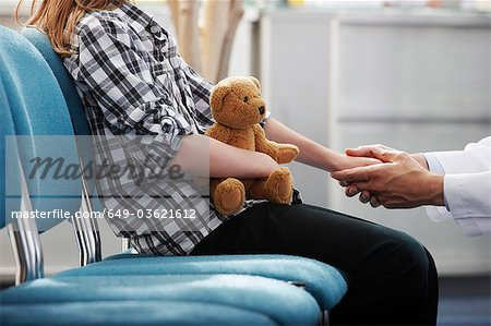 Doctor holding young girls hand Stock Photo - Premium Royalty-Free, Image code: 649-03621612