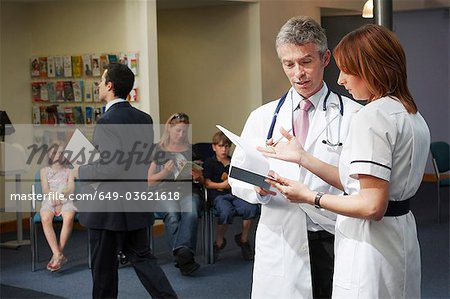 Doctor and nurse in waiting area Stock Photo - Premium Royalty-Free, Image code: 649-03621618