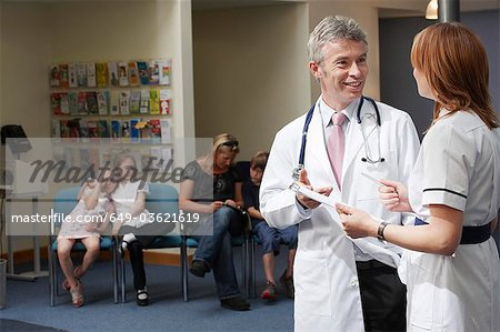 Doctor and Nurse in waiting area Stock Photo - Premium Royalty-Free, Image code: 649-03621619