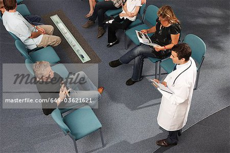 Doctor and patients in waiting area Stock Photo - Premium Royalty-Free, Image code: 649-03621621