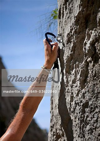 Rock climber securing himself Stock Photo - Premium Royalty-Free, Image code: 649-03622060