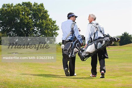 Walking over the golf course Stock Photo - Premium Royalty-Free, Image code: 649-03622304