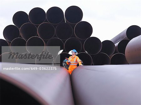 Man checking pipes Stock Photo - Premium Royalty-Free, Image code: 649-03622375
