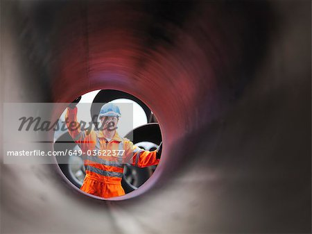 Man checking pipes Stock Photo - Premium Royalty-Free, Image code: 649-03622377