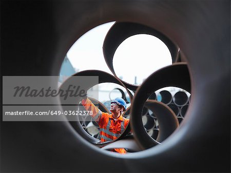 Man checking pipes Stock Photo - Premium Royalty-Free, Image code: 649-03622378