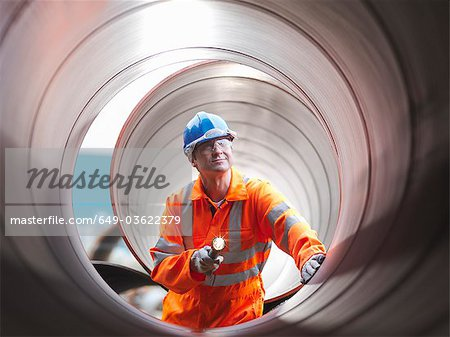 Man checking pipes Stock Photo - Premium Royalty-Free, Image code: 649-03622379